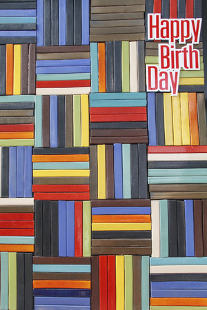 happy birth day: Textured ceramic wall tile with word happy birth day