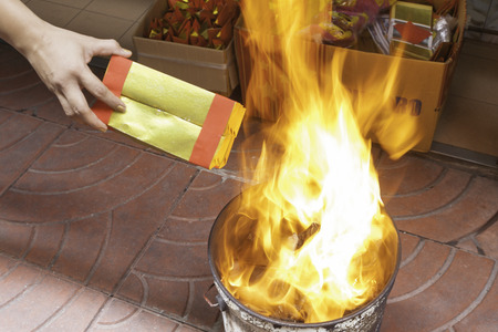 people burns joss paper for ancestor in chinese new year