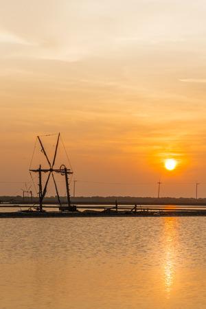 briny: Sunset in the salt fields at Samut Sakhon, Thailand Stock Photo