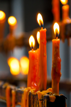 Flame of burning candles in a temple