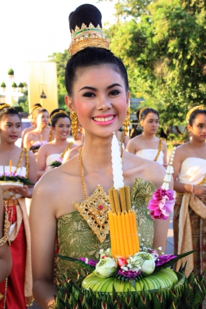 tradional: A cheerful woman with tradional clothing is holding Kratong in Loykratong festival Thailand.