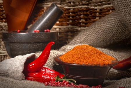 Chillies with granite pestle and mortar photo