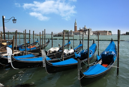 Gondolas docked on the venetian lagoon photo