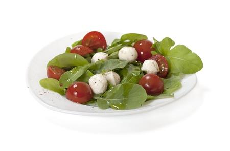 Salad with mozzarella and arugula, isolated on white background