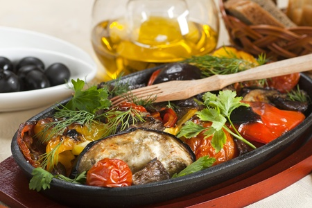 Grilled eggplants with pepper,tomato and greens