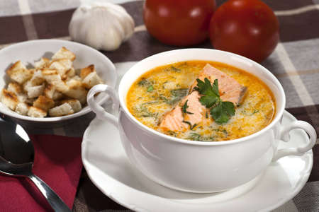 Creamy salmon soup with croutons Stock Photo