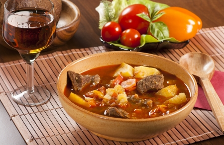 Goulash with stewed beef, potatoes, red pepper and other spices photo