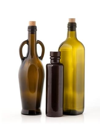 Three empty glass oil bottles Stock Photo