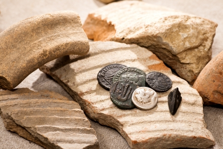 Ancient coins and broken earthenware photo