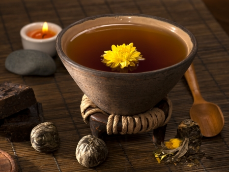 Organic tea with chrysanthemum flower photo
