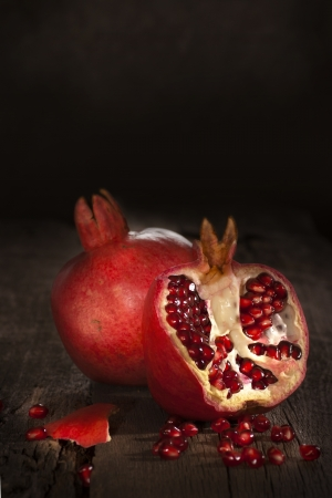 pomegranate juice: Two pomegranats still-life in dark tones