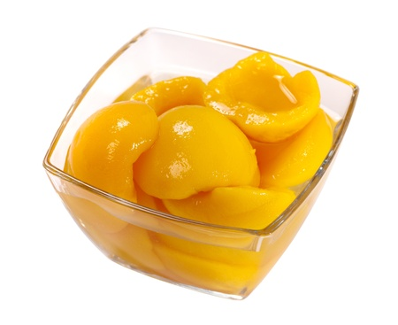 Tinned peach compote isolated on white background Stock Photo