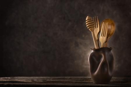 Wooden cutlery set on dark background Stock Photo