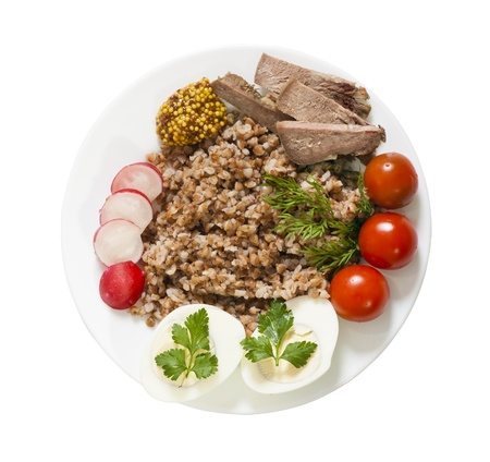 Buckwheat with meat and vegetables isolated on white top view