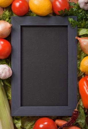 Black menu blackboard  with vegetables