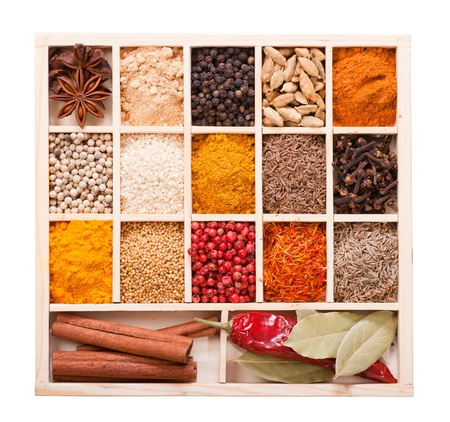 Assorted spices in the wooden box isolated on white background Stock fotó