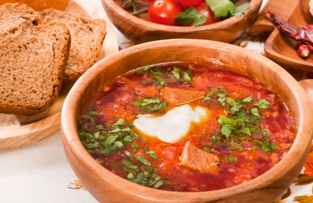 Ukrainian and russian traditional  borsch with beetroot, cabbage and tomatoes