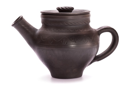 Black clay teapot isolated on white photo