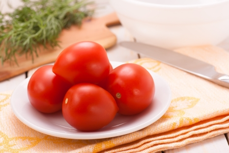 Ripe plum tomatoes with greens