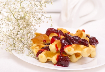 Wafers on plate and  flowers