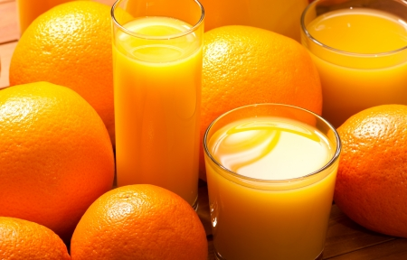 Glasses of  juice  and orange fruits Stock Photo