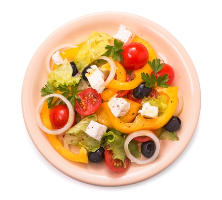 Greek salad isolated top view photo