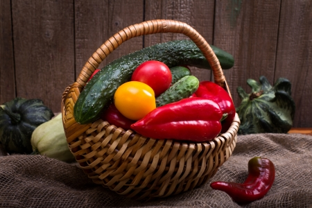 Basket of various vegetables still-life photo
