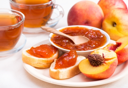 jellies: Sweet peach jam on bread horizontal
