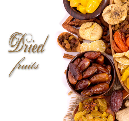Dried fruits on white background with sample text photo