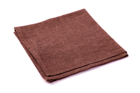Brown rough napkin on a white background photo
