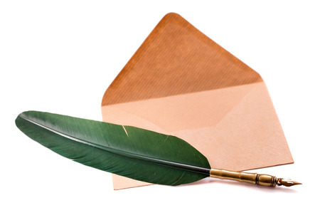 Quill pen and envelope isolated