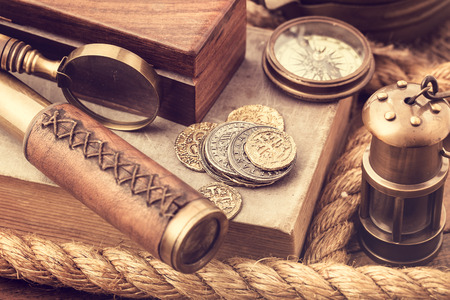 Old coins and vintage nautical accessories photo