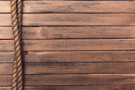 boat deck: Rope on old wooden board background vertical