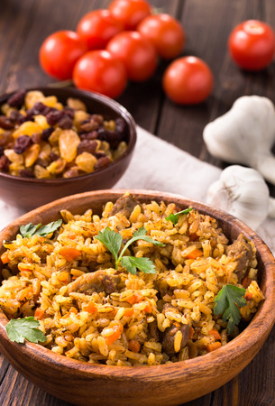 brown rice: Wooden bowl of pilaf and vegetables Stock Photo