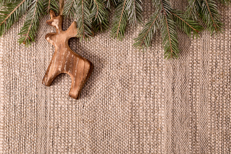 christmas decoration with fir branch and wooden deer above crafts textile background horizontal stock photo - Wooden Deer Christmas Decorations