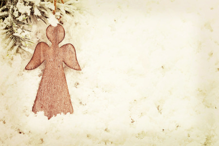angel tree: Vintage wooden Christmas angel decoration on snow background
