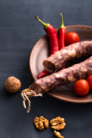 air dried salami: Wet-cured sausage with walnut and chili peppers