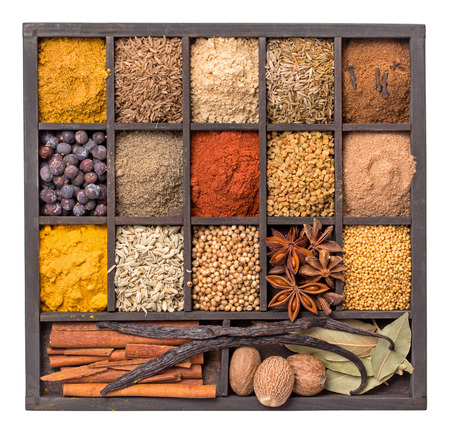 fenugreek: Various herbs and powder spices in box isolated closeup