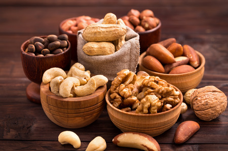 Variety of nuts: walnut, hazelnut, cashew, peanuts,  pine nuts and other Stock Photo
