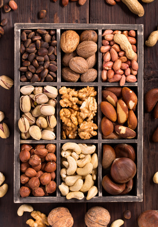 pine nuts: Box of variety nuts top view Stock Photo