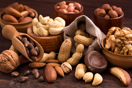 Different types of nuts: walnut, hazelnut, cashew, peanuts; brazil nuts, pine nuts and other