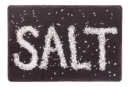 Salt lettering over dark gray slate background isolated