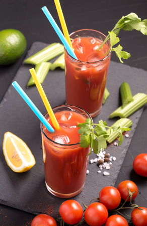 bloody mary cocktail: Two glasses of Bloody Mary cocktail drink above