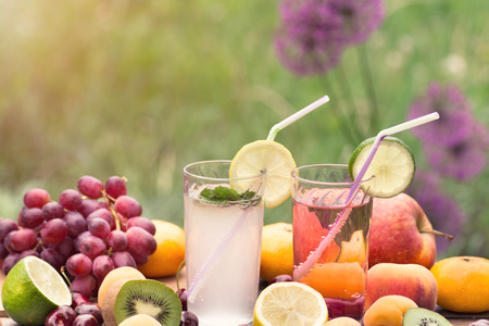 outdoor shot: Fresh lemonade and ripe fruits outdoor shot