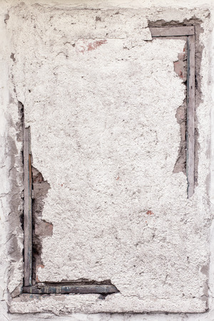 grunge frame: Old plastered wall with wooden frame