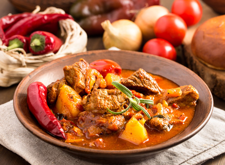 Goulash in ceramic plate. Traditional hungarian meal.