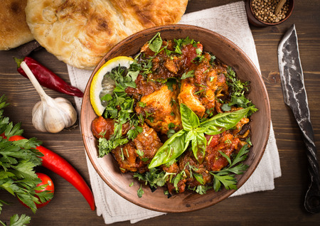 Chakhokhbili - traditional Georgian dish. Chicken stewed with tomatoes and herbs.Top view 版權商用圖片