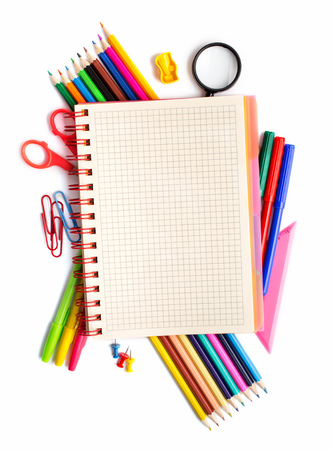 stationery items: Notebook on stationery items placed  around on white above