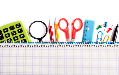 pencil and paper: Notebook on stationery items on white above
