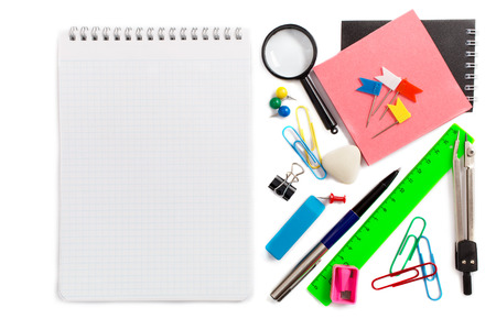 stationery items: Notebook and stationery items beside on white background